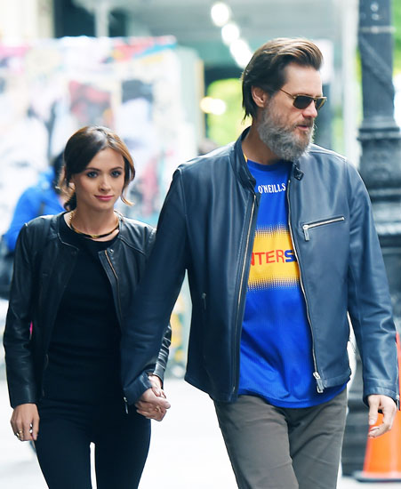 UK CLIENTS MUST CREDIT: AKM-GSI ONLY Jim Carrey and his girlfriend, Cathriona White, hold hands while taking a walk in Manhattan.  The on/off couple are back together after a six month split. Pictured: Jim Carrey and Cathriona White Ref: SPL1033947  210515   Picture by: AKM-GSI / Splash News